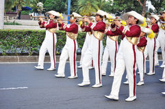 Boys blowing trumpet in marching band Stock Photo