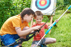 Boys with bows near sport aim Royalty Free Stock Images