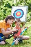 Boys with bows near sport aim Stock Photography