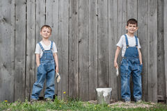 Boys with brushes and paint at an old wall Stock Images
