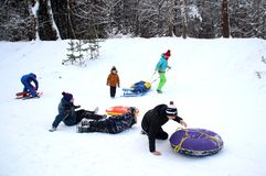 The boys bumped into each other. Winter fun. The action takes place on the outskirts of the city of Monino. Residents of the town come with children on a snow royalty free stock photos