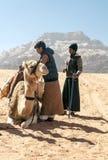 Boys with a camel Stock Photos