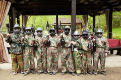 Boys in camouflage suits with paintball markers Stock Image