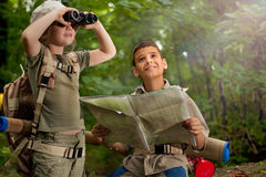 Boys on camping trip in the forest exploring Royalty Free Stock Image