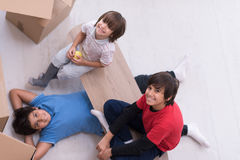 Boys with cardboard boxes around them top view Stock Image
