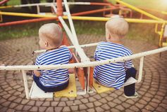 Boys on carousel Stock Images