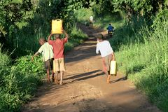 Boys carrying water Royalty Free Stock Photo