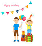 The boys celebrate birthday together with presents and poppers. The boys celebrate a birthday, keep balloons and party poppers, and standing next to a large Stock Photos