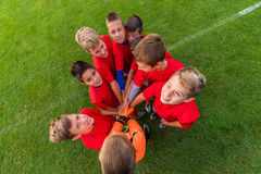 Boys celebrating after soccer match Royalty Free Stock Photos