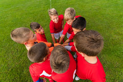 Boys celebrating after soccer match Stock Photo