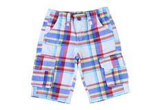 Boys checkered shorts on white background. Children& x27;s clothes for summer Stock Images