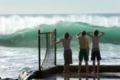 Boys Checking Out The Surf royalty free stock images