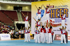 Boys' Cheerleading Action. Image of a boys' cheerleading team in action at Cheers 2009, which is the Malaysian national cheerleading championship, held at Juara Royalty Free Stock Photography