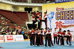 Boys' Cheerleading Action. Image of a boys' cheerleading team in action at Cheers 2009, which is the Malaysian national cheerleading championship, held at Juara Stock Images