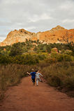 Boys children running path mountain canyon Royalty Free Stock Photography