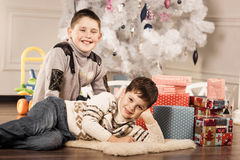 Boys with Christmas gifts Stock Images