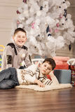Boys with Christmas gifts Royalty Free Stock Photos