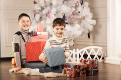 Boys with Christmas gifts Stock Photography