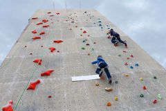 Boys climbing with rope at outdoor festival White Nights Royalty Free Stock Photos