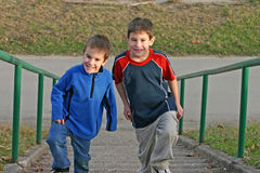 Boys Climbing Stairs Royalty Free Stock Images