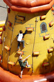 Boys, climbing on tower Stock Images