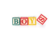 BOYS with colorful alphabet blocks on white background Stock Photos