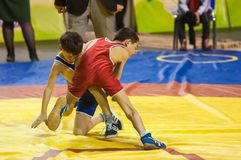 The boys compete in Greco-Roman wrestling, Orenburg, Russia. Orenburg, Russia - 07.04.2015: Youth tournament Orenburg oblast in Greco-Roman wrestling, dedicated Stock Photo