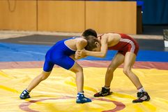 The boys compete in Greco-Roman wrestling, Orenburg, Russia. Orenburg, Russia - 07.04.2015: Youth tournament Orenburg oblast in Greco-Roman wrestling, dedicated Royalty Free Stock Images