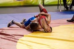 The boys compete in Greco-Roman wrestling, Orenburg, Russia Royalty Free Stock Photo