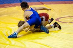 The boys compete in Greco-Roman wrestling, Orenburg, Russia. Orenburg, Russia - 07.04.2015: Youth tournament Orenburg oblast in Greco-Roman wrestling, dedicated Royalty Free Stock Photos
