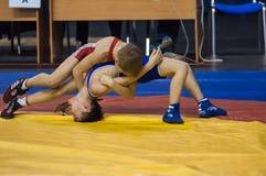 The boys compete in Greco-Roman wrestling, Orenburg, Russia. Orenburg, Russia - 07.04.2015: Youth tournament Orenburg oblast in Greco-Roman wrestling, dedicated Royalty Free Stock Images