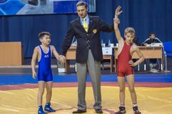 The boys compete in Greco-Roman wrestling, Orenburg, Russia. Orenburg, Russia - 07.04.2015: Youth tournament Orenburg oblast in Greco-Roman wrestling, dedicated Stock Images