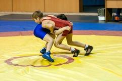 The boys compete in Greco-Roman wrestling, Orenburg, Russia. Orenburg, Russia - 07.04.2015: Youth tournament Orenburg oblast in Greco-Roman wrestling, dedicated Royalty Free Stock Photography