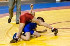 The boys compete in Greco-Roman wrestling, Orenburg, Russia. Orenburg, Russia - 07.04.2015: Youth tournament Orenburg oblast in Greco-Roman wrestling, dedicated Stock Photos