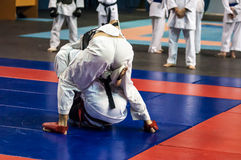 The boys compete in the Kobudo Stock Images
