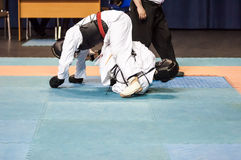 The boys compete in the Kobudo. Kobudo Japanese martial art of self-defence without arms Royalty Free Stock Photo