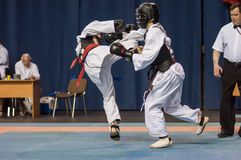 The boys compete in the Kobudo. Orenburg, Russia - 2 May 2015: The boys compete in the Kobudo on superiority of the Orenburg region on East combat martial art Stock Image