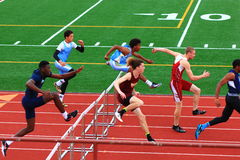 Boys competing in hurdles at a Track Competition Royalty Free Stock Photo