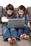 Boys with computer Stock Images