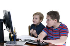 Boys on Computer. Two young boy playing on a computer. Education, learning, internet Royalty Free Stock Photography