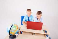 Boys at a computer on the Internet school lessons Stock Photography