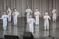 Boys in costumes of astronauts performs on stage Stock Images