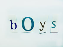 Boys - Cutout Words Collage Of Mixed Magazine Letters with White Background. Caption composed with letters torn from magazines with White Background Royalty Free Stock Photography