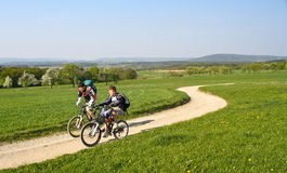 Boys cycling in springtime Bavaria, Germany. Young boys enjoying the first warm days in spring Stock Image