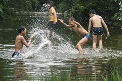 Boys dabbling in the brook in chengdu,china Stock Image