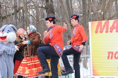 Boys dance on the Day of Maslenitsa in the city of Kanash, Chuvashia, Russia stock photography