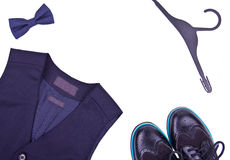 Boys dark blue vest with bow tie, hanger and modern shoes Stock Image