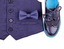 Boys dark blue vest with bow tie and modern shoes Stock Photo