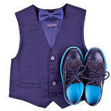 Boys dark blue vest with bow tie and modern shoes Stock Photos