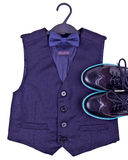 Boys dark blue vest with bow tie and modern shoes Royalty Free Stock Photos